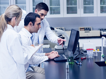 Medical researchers in front of the computer